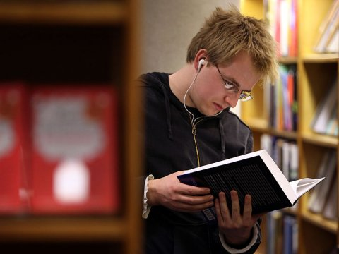 student-reading-book